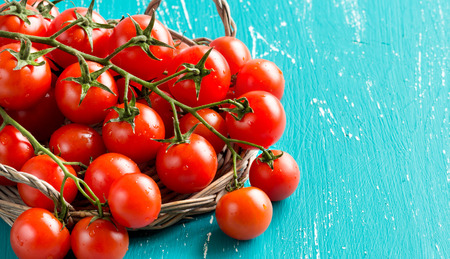cherry: Cherry tomatoes on old turquoise wooden  background