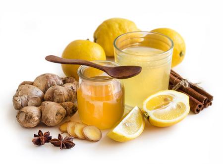 jar: Miel, limón y jengibre tónico y estropeaban close up Foto de archivo