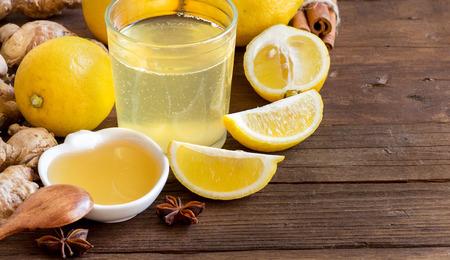 ingridients: Honey, lemon, ginger tonic and ingridients on wood Stock Photo