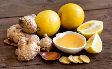 Honey, lemon and ginger on old wooden table Stock Photo