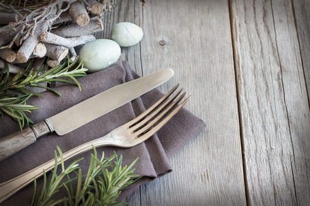 table linen: Easter table setting with eggs and rosemary