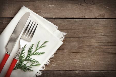 holiday meal: Festive table setting with napkin on wooden background