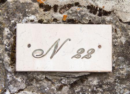 twenty two: Number twenty two on the grey stone  wall