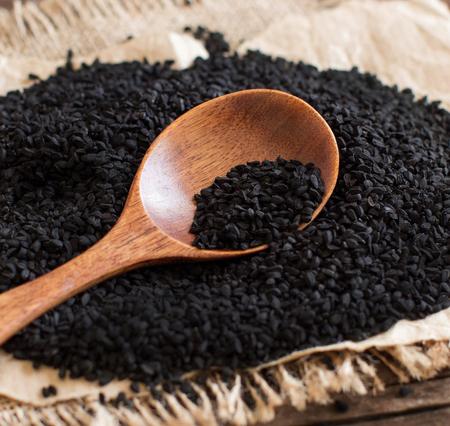 Nigella sativa or Black cumin with a spoon close up