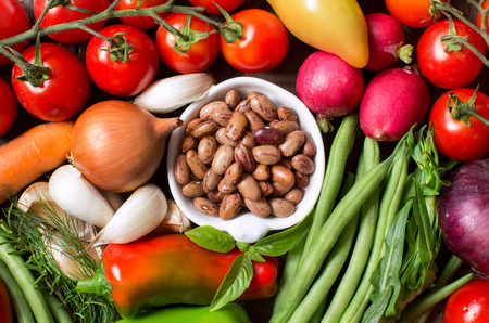 pinto beans: Pinto beans in a bowl with fresh  vegetables