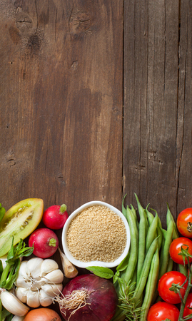 raddish: CousCous in a bowl and fresh vegetables on wood Stock Photo