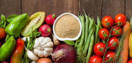 whole wheat: CousCous in a bowl and fresh vegetables on wood Stock Photo