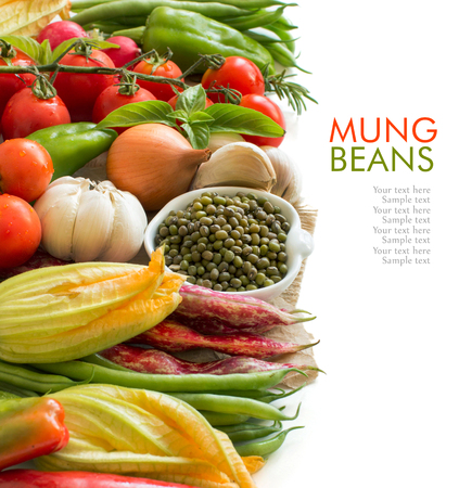 fiber food: Raw organic mung beans in a bowl and vegetables isolated on white Stock Photo
