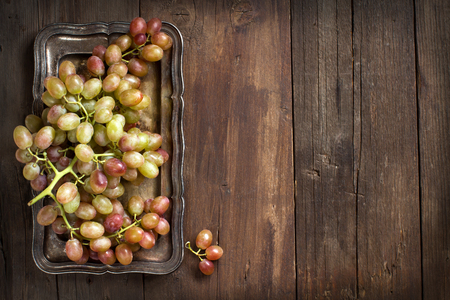 wine grapes: Grapes on silver tray on an Old Wooden Background Stock Photo