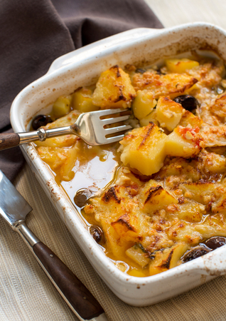 bakeoven: Fish with potatoes  and olives cooked in oven in small casserole