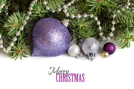 purple: Silver and purple Christmas ornaments border on white background Stock Photo