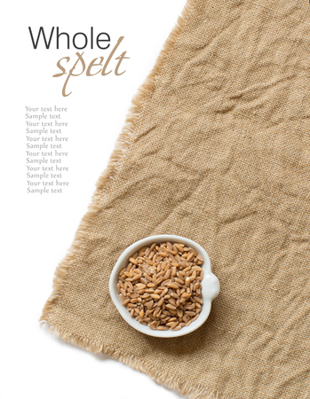 unpolished: Whole unpolished spelt in a bowl on burlap