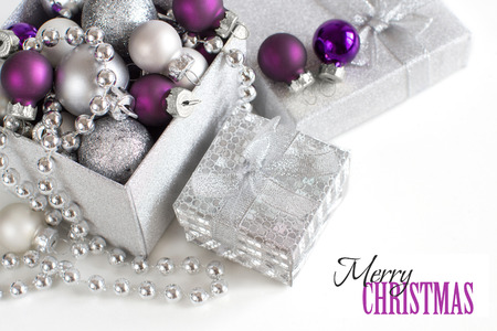 Silver and purple Christmas ornaments border on white background Archivio Fotografico