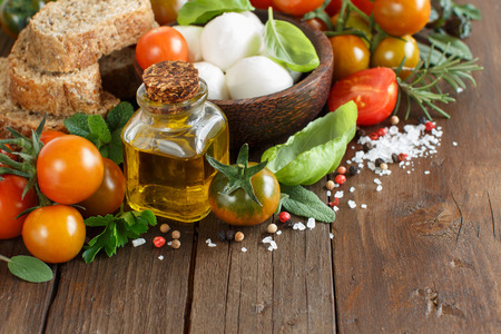 olive green: Italian cooking ingridients : mozzarella, tomatoes, basil,  olive oil and other