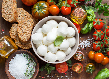 ingridients: Italian cooking ingridients : mozzarella, tomatoes, basil, olive oil and other Stock Photo