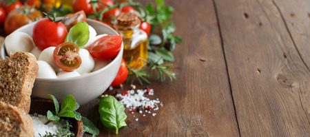 olive green: Italian ingridients for caprese salad on wooden background