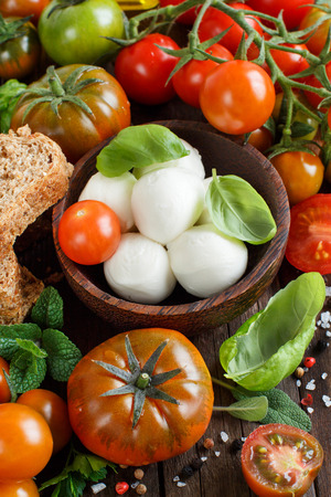 ingridients: Italian ingridients for caprese salad on wooden background