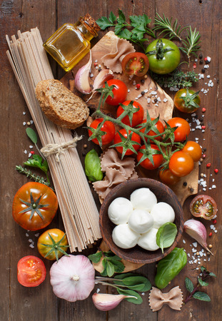 ingridients: Italian cooking ingridients : mozzarella, pasta, tomatoes, garlic, herbs,  olive oil and other