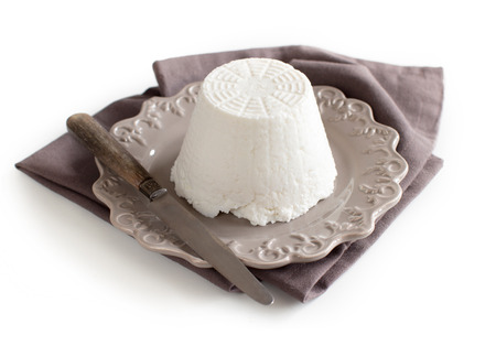 Italian ricotta cheese with knife on napkin  isolated on white 版權商用圖片