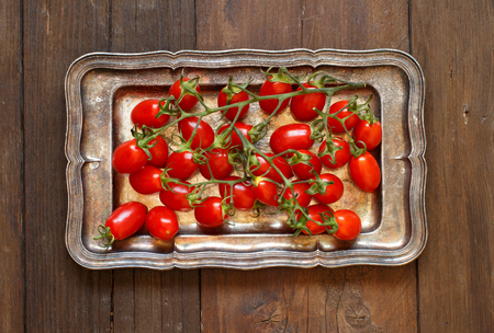 Cherry tomatoes on a metal tray top view