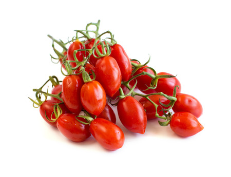 Fresh cherry tomatoes isolated on white background