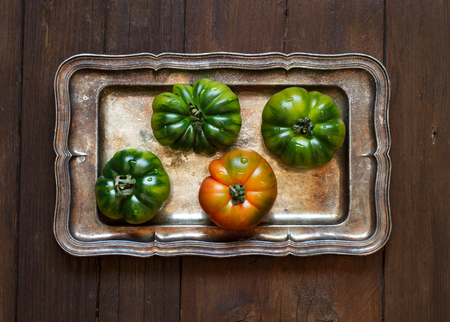 Costoluto tomatoes on a metal tray top view Stock Photo