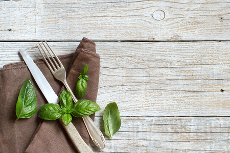 Vintage fork and knife on a napkin on a old wooden table Archivio Fotografico