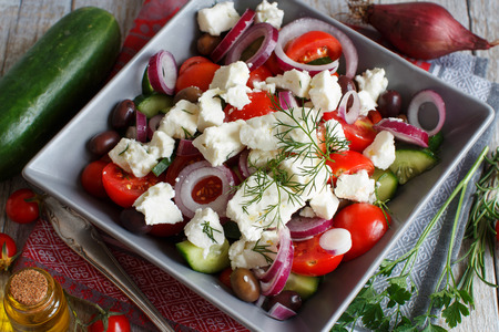 l plate: Greek salad with tomatoes, feta cheese, cucumbers, onions and olives