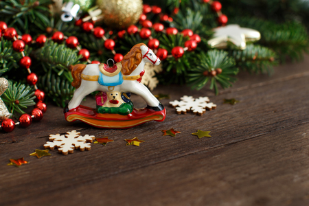 festive decorations with rocking horse and christmas decorations on wood stock photo 66229703