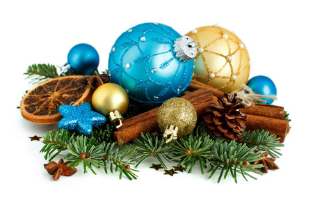Turquoise and golden Christmas ornaments on white background