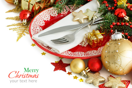 Red and golden festive table setting isolated on white