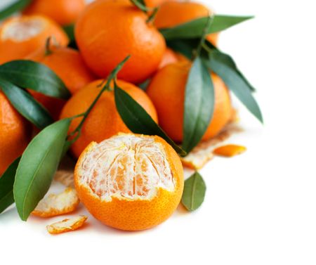 Mandarins with leaves on a white background close up Archivio Fotografico