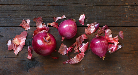 Red onions on a wooden table top view