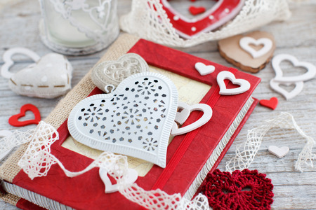 Valentine day decorations with notebook and hearts
