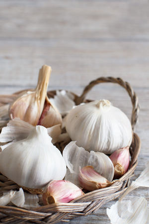 Organic garlic on the old wooden table close up Archivio Fotografico