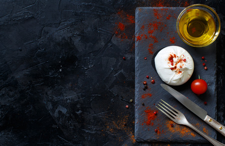 Italian cheese burrata, tomatoes, spices and olive  oil