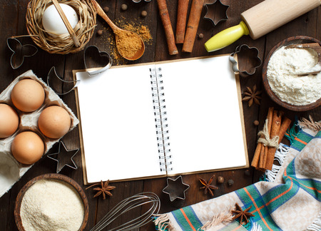 Blank cooking book, ingredients and utensils top view