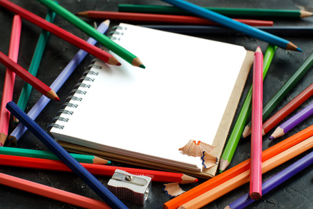 Drawing-pad and color pencils  on a dark background