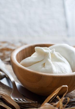 Italian cheese burrata in a bowl close up