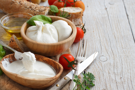 Italian cheese burrata with bread, vegetables  and herbs 版權商用圖片