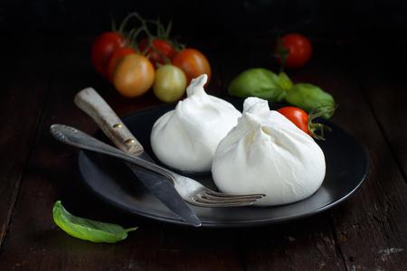 Italian cheese burrata, tomatoes,  basil