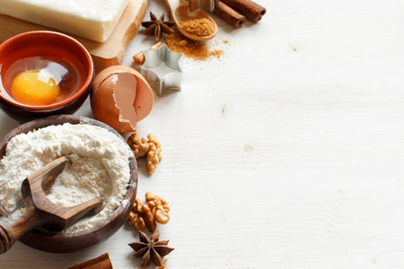 Ingredients and utensils for baking on a wooden background Archivio Fotografico