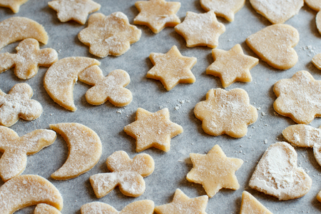 pastry cutters: Close up of cookies before oven on a paper