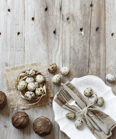 Rustic Easter table setting with eggs on a wooden table