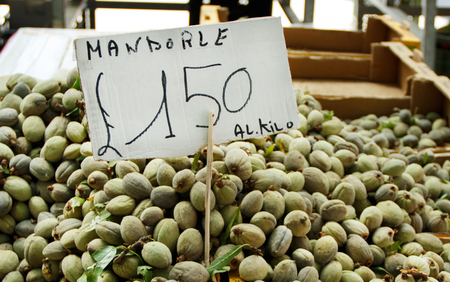 Fresh almond fruit with price on a local farmers market
