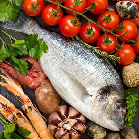 Fresh dorado fish,  seafood and vegetables