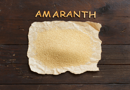 Pile of Raw Organic Amaranth grain with letters Archivio Fotografico