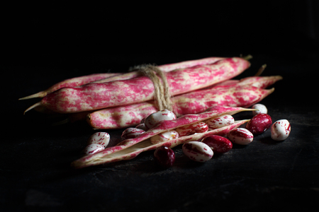 Pinto beans with pods on a dark backgroundclose up