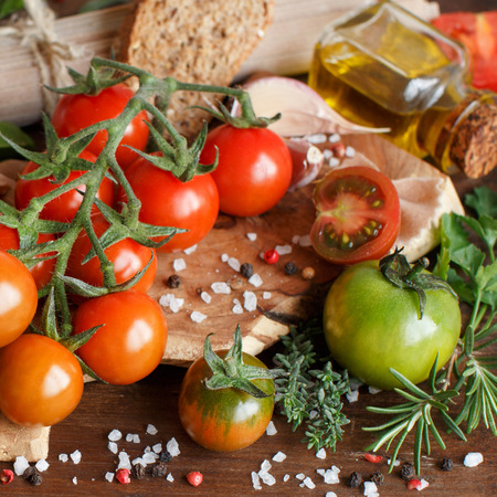 Italian cooking ingredients : mozzarella, tomatoes, basil, olive oil and other Archivio Fotografico