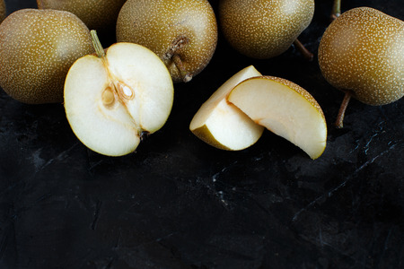 Nashi Pears (apple pears or asian pears) on a dark background Archivio Fotografico